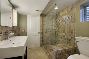 Tiled Bathroom with Clear Glass Shower Enclosure